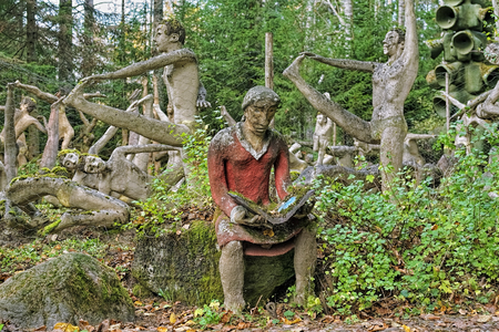 PARIKKALA, FINLAND - OCTOBER 9, 2011: Sculptures by ITE-artist Veijo Ronkkonen in his sculpture park (Parikkalan patsaspuisto). The park contains about 560 concrete statues and a magnificent garden.