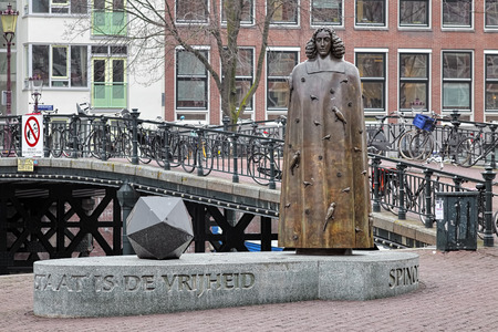 AMSTERDAM, NETHERLANDS - JANUARY 25, 2017: Spinoza Monument. The monument by the Dutch sculptor Nicolas Dings was unveiled on November 24, 2008 at Zwanenburgwal canal.