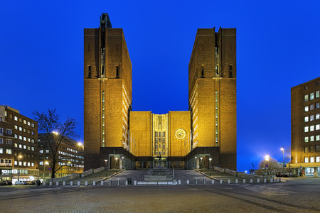 Oslo City Hall in night, Norway. View of the northern side with main entrance from the Fridtjof Nansen square. Stock Photo
