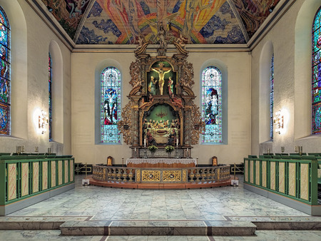 OSLO, NORWAY - JANUARY 22, 2017: Altar of Oslo Cathedral with wooden altarpiece. The altarpiece was initiated by unknown Dutch artist and completed by Norwegian woodcarver Lars Sivertsen in 1699.