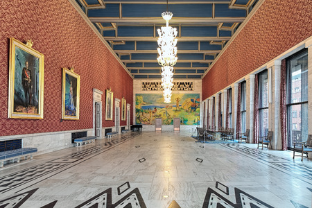 OSLO, NORWAY - JANUARY 22, 2017: Interior of Banquet Hall in Oslo City Hall. The long wall holds the portraits of the Norwegian kings and queen. The end wall adorned with fresco by Willi Midelfart. Editorial