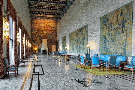 OSLO, NORWAY - JANUARY 24, 2017: Interior of Festival Gallery in Oslo City Hall with frescoes by Axel Revold and tapestries by design of Kare Jonsborg, dedicated to the pivotal industries of Norway. Editorial