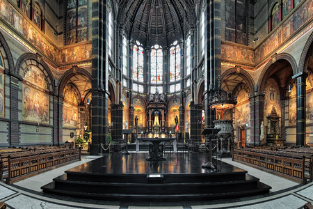 AMSTERDAM, NETHERLANDS - JANUARY 25, 2017: Chancel and altar of St. Nicholas Basilica (Nicolaaskerk), the citys major Catholic church. The church was built in 1884-1887 by design of Adrianus Bleijs.