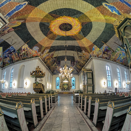 OSLO, NORWAY - JANUARY 23, 2017: Interior of Oslo Cathedral. The 1,500 square meters large modernist ceiling paintings was painted by the Norwegian artist Hugo Lous Mohr in 1937-1950.