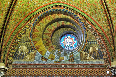 schulek: BUDAPEST, HUNGARY - DECEMBER 5, 2016: The round window at the bottom of the short tower (the Bela Tower) of Matthias Church, view from inside the church. The window designed by Frigyes Schulek.
