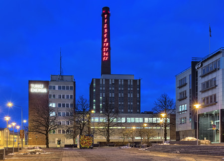 TURKU, FINLAND - MARCH 3, 2017: Fibonacci Sequence 1-55 in neon lights on the chimney of Turku Energia in night. It was created by Italian artist Mario Merz in 1994 for an environmental art project. Stock Photo
