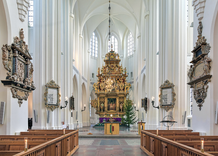 MALMO, SWEDEN - DECEMBER 13, 2015: Chancel and altar of St. Peters Church (Sankt Petri kyrka). The altar, which was completed in 1611, is the largest wooden altar in northern Europe.