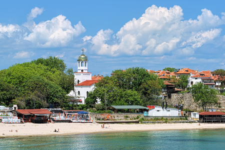 View of St. Cyril and St. Methodius Church and central beach in Sozopol, Bulgaria. Sozopol is the famous seaside resort on the coast of Black Sea. Photo taken in spring before the start of high season Stock Photo