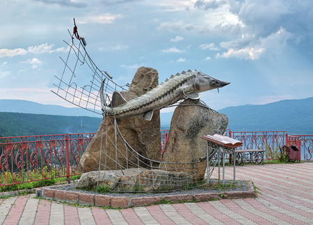 80th: OVSYANKA, RUSSIA - AUGUST 15, 2016: Tsar-Fish Sculpture on the Sliznevskiy Cliff over the Yenisei River. It was unveiled on May 1, 2004 to commemorate the 80th anniversary of writer Viktor Astafyev.