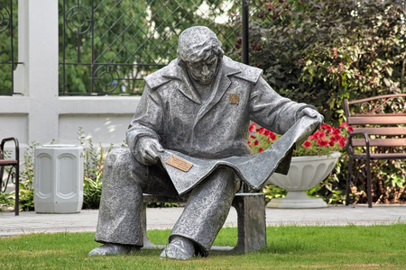 steelmaker: YEKATERINBURG, RUSSIA - AUGUST 20, 2016: Sculpture of Steelmaker reading a newspaper, in the garden of Journalists House. It was made in 1980s by Andrey Antonov for the Urals Worker Publishing House. Editorial