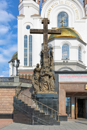 grand sons: YEKATERINBURG, RUSSIA - AUGUST 20, 2016: Monument to royal family of Nicholas II in front of the Church on Blood. The monument was made by sculptor Konstantin Grunberg and architect Alexander Mazaev.