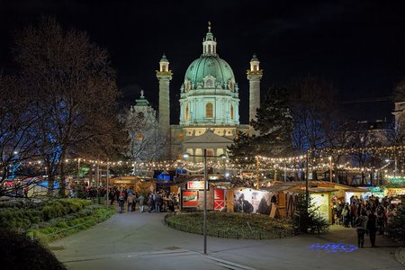 VIENNA, AUSTRIA - DECEMBER 9, 2016: Karlsplatz Christmas market in front of Karlskirche church. The market is focused on authentic handicrafts made by local artists rather than massproduced gifts.