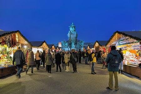VIENNA, AUSTRIA - DECEMBER 8, 2016: Christmas Village on Maria-Theresien-Platz. Surrounding the statue of Habsburg Empress Maria Theresa, the market offers the Christmas Punch and sweet snacks. Editorial