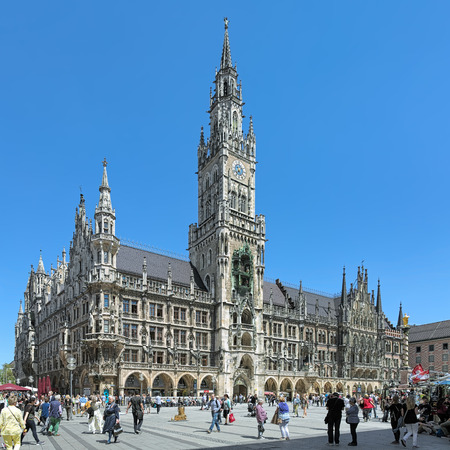 spire: MUNICH, GERMANY - MAY 17, 2017: New Town Hall on Marienplatz square. It was built in 1867-1908 by design of the German-Austrian architect Georg von Hauberrisser in a Gothic Revival style. Editorial