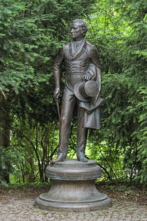 inscriptions: MUNICH, GERMANY - MAY 30, 2017: Fyodor Tyutchev monument. The monument by the Russian sculptor Andrey Kovalchuk was unveiled on December 11, 2003 to commemorate the 200th anniversary of the poet. Editorial