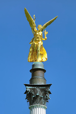 Angel of Peace on the top of Friedensengel monument in Munich, Germany. The monument was founded in 1896 to commemorate the 25 peaceful years after the Franco-German war of 1870-1871. Stock Photo