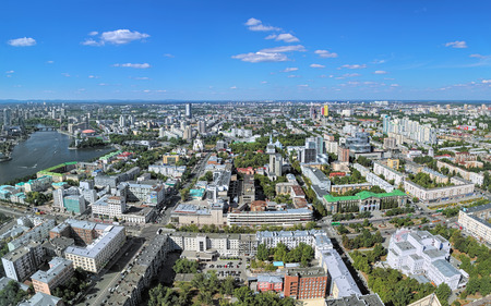 ural: YEKATERINBURG, RUSSIA - AUGUST 19, 2016: Panoramic view of the citys central and northern parts. View from the observation deck on the 52nd floor of Vysotsky skyscraper at 186 meters above the ground Editorial