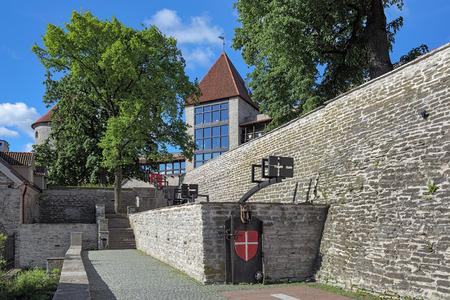 obtaining: TALLINN, ESTONIA - JUNE 21, 2017: Danish Kings Garden with Dannebrog Monument on the legendary place where the Danish flag fell from sky on June 15, 1219. The monument was unveiled on May 15, 2012.
