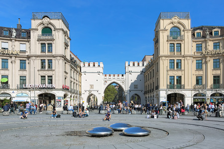 mentioned: MUNICH, GERMANY - MAY 16, 2017: Karlsplatz square (more often called Stachus) and Karlstor gate in sunny day. The gate was built between 1285 and 1347, and first mentioned in documents in 1302.