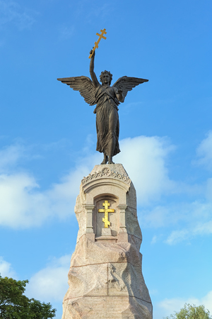 TALLINN, ESTONIA - JULY 27, 2016: Angel on the top of The Russalka Memorial. The memorial was erected on September 7, 1902 to mark the ninth anniversary of the sinking of the Russian warship Russalka.