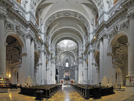 MUNICH, GERMANY - MAY 29, 2017: Interior of Theatinerkirche (Theatine Church of St. Cajetan). The church was designed in Italian high-Baroque style by architect Agostino Barelli and built in 1663-1690.