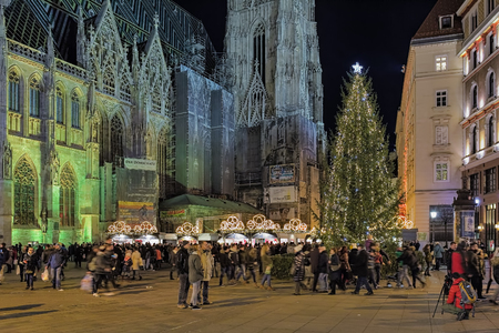 saint: VIENNA, AUSTRIA - DECEMBER 10, 2016: Stephansplatz Christmas market around the St. Stephens Cathedral. The Christmas market in the heart of Vienna Old Town offers high-quality products from Austria.