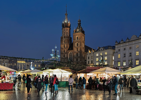 KRAKOW, POLAND - DECEMBER 14, 2016: Christmas market on the Main square (Rynek Glowny) in front of St. Marys Basilica. The market starts in the last week of November and lasts through December 26th.