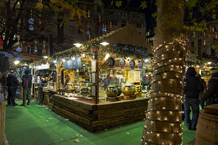 BUDAPEST, HUNGARY - DECEMBER 6, 2016: Market booth with traditional Hungarian Christmas food, sweets and drinks at the Christmas Fair and Winter Festival on the Vorosmarty Square in evening.