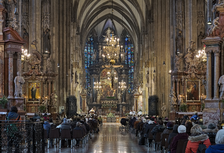 stephen: VIENNA, AUSTRIA - DECEMBER 8, 2016: Holy mass in St. Stephens Cathedral. The cathedral is the mother church of the Roman Catholic Archdiocese of Vienna and the seat of the Archbishop of Vienna.