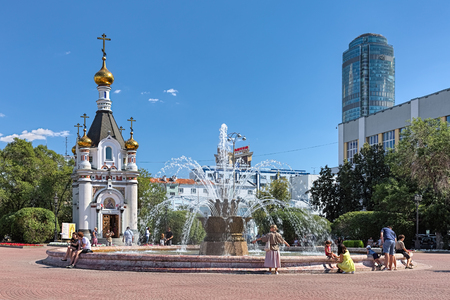 YEKATERINBURG, RUSSIA - AUGUST 19, 2016: Square of Labor with the Stone Flower Fountain (1960, architect Pyotr Demintsev) and Chapel of St. Catherine (1987-1988, architect Alexander Dolgov).