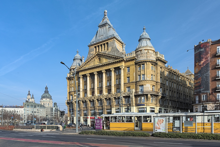 BUDAPEST, HUNGARY - DECEMBER 5, 2016: Anker House. It was built in 1908-1910 by order of Vienna Insurance Company Anker. The dome and towers of St. Stephens Basilica are visible in the background.