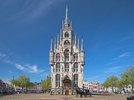 GOUDA, NETHERLANDS - MAY 24, 2015: Town Hall and a horse carriage on the Markt square. The Town Hall was built in 1448-1459. This is the one of the oldest gothic town halls in the country. Editorial