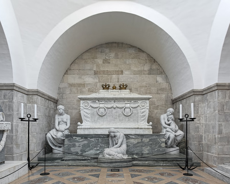 ROSKILDE, DENMARK - DECEMBER 14, 2015: Sarcophagus of king Christian IX of Denmark and queen Louise in Glucksburger Chapel of Roskilde Cathedral. The statues was made in 1908 by Edvard Eriksen.