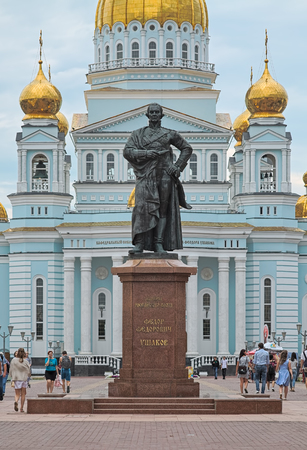 SARANSK, RUSSIA - AUGUST 16, 2018: Fyodor Ushakov Monument on the background of Cathedral of St. Theodore Ushakov. Monument was unveiled on August 11, 2006. Cathedral was consecrated on August 6, 2006. Editoriali