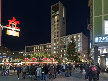 STUTTGART, GERMANY - DECEMBER 14, 2017: Christmas market at Marktplatz (Market Square) in front of Town Hall in dusk. The Stuttgart Christmas market was officially mentioned for the first time in 1692.