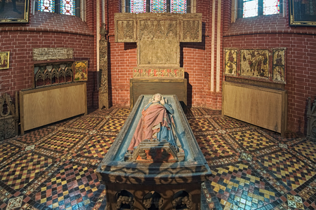 BAD DOBERAN, GERMANY - OCTOBER 22, 2016: Tomb of Queen Margarete of Denmark (Margaret Sambiria of Pomerania) in Doberan Minster. The figure of Margaret was carved from oak in the 13th century.