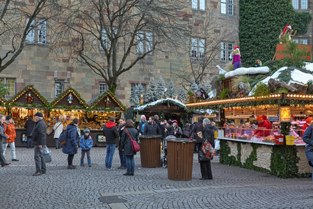 STUTTGART, GERMANY - DECEMBER 14, 2017: Christmas market at Schillerplatz square close to Altes Schloss (Old Castle). The Stuttgart Christmas market was officially mentioned for the first time in 1692. Editorial