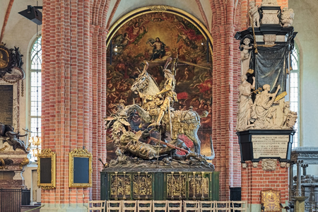 STOCKHOLM, SWEDEN - APRIL 3, 2016: Saint George and the Dragon, an extremely well-preserved wooden sculpture in Storkyrkan (The Great Church). It was created by Bernt Notke from Lubeck in 1489. Editorial