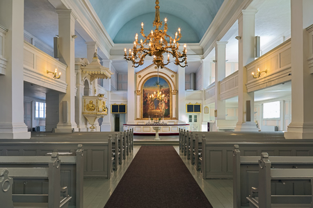 HELSINKI, FINLAND - MARCH 6, 2017: Interior of the Old Church of Helsinki. The church was built in 1824-1826 by design of Carl Ludvig Engel. The altarpiece by Robert Wilhelm Ekman was placed in 1854.