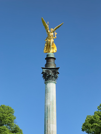 Angel of Peace on the top of Friedensengel monument in Munich, Germany. The monument was founded in 1896 to commemorate the 25 peaceful years after the Franco-German war of 1870-1871. Foto de archivo