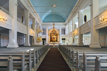 HELSINKI, FINLAND - MARCH 6, 2017: Interior of the Old Church of Helsinki. The church was built in 1824-1826 by design of Carl Ludvig Engel. The organ by Per Larsson Akermann was installed in 1869.