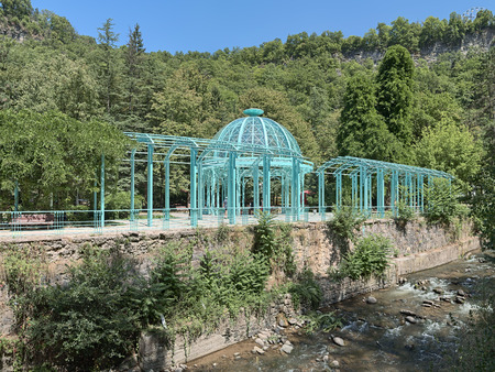 Pavilion above the Yekaterininskiy Spring of mineral water in the Borjomi Central Park close to Borjomula river, Georgia