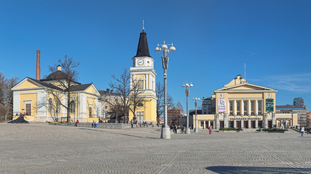 TAMPERE, FINLAND - MARCH 16, 2015: Central Square with Old Church (1824, architect Charles Bassi), Belfry (1828, architect Carl Ludvig Engel), Tampere Theater (1912, architects Kauno and Oiva Kallio).