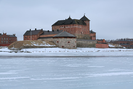 Hameenlinna, Finland. Hame Castle or Tavastia Castle in winter overcast day. The castle was constructed in the 13th century.