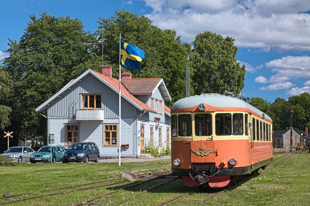 VADSTENA, SWEDEN - AUGUST 25, 2013: Vadstena station of narrow-gauge railway Vadstena-Fagelsta and railcar SJ Y6 YBo5p. Railway was put into operation in 1874. Since 1974, it uses as a museum railway.