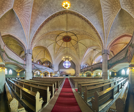 TAMPERE, FINLAND - MARCH 5, 2019: Panoramic view of interior of Tampere Cathedral. Cathedral was built in 1902-1907 by design of Lars Sonck. Frescoes in interior painted by Hugo Simberg in 1905-1906.