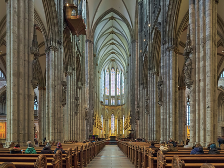 COLOGNE, GERMANY - DECEMBER 10, 2018: Interior of Cologne Cathedral. The cathedral is Germanys most visited landmark, attracting an average of 20,000 people a day, or seven to eight million a year. Redactioneel