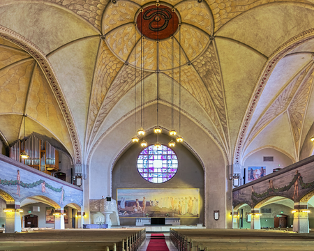 TAMPERE, FINLAND - MARCH 5, 2019: Interior of Tampere Cathedral. The cathedral was built in 1902-1907 by design of Lars Sonck. Frescoes in the interior painted by Hugo Simberg in 1905-1906.