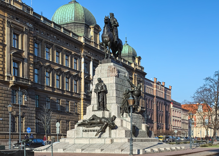 KRAKOW, POLAND - DECEMBER 16, 2016: Battle of Grunwald Monument and former building of Directorate General of the Eastern Railway. The monument by Antoni Wiwulski was unveiled on July 15, 1910.