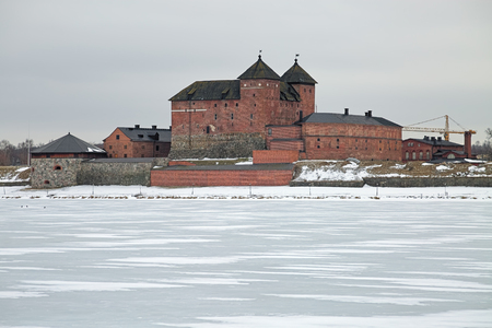 HAMEENLINNA, FINLAND - MARCH 4, 2019: Hame Castle or Tavastia Castle in winter overcast day. The castle was constructed in the 13th century. Redactioneel